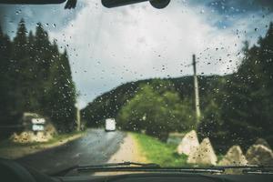 Rainy windshield and road view photo