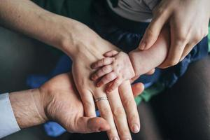 Family of three's hands