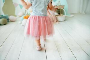 Little girl in a tulle skirt photo