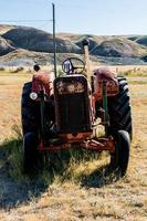 Red farming tractor photo