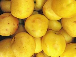 Close-up of pile of yellow apples photo