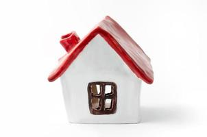 Small white porcelain house with a red roof photo