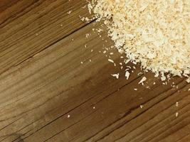 Sawdust on a black table background photo