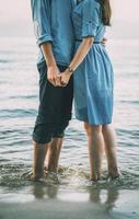 Couple in blue denim in water