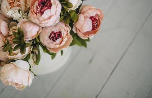 Peach peonies with copy space photo