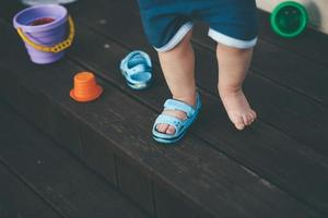 Child with one shoe photo