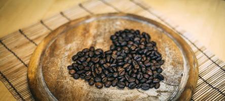Coffee beans in heart shape photo