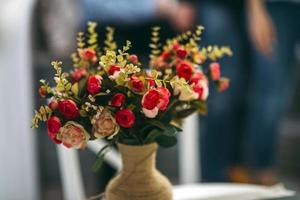 Red floral bouquet in a vase photo