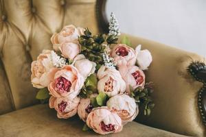 Peony bouquet in a chair photo