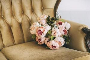 Peonies in a chair photo