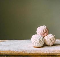 Marshmallows desserts on table photo