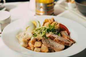 Caesar salad with chicken photo