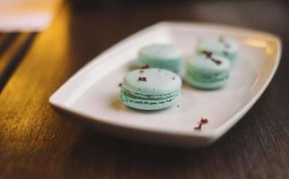 Blue macaroons on a plate