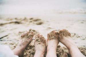 Feet in sand photo