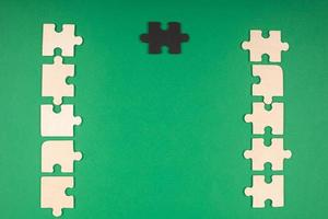 Green background with puzzles and copy space photo