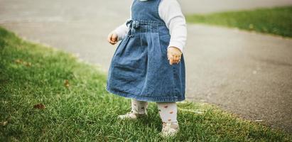 Child in a denim dress photo
