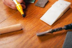 Repair restoration of laminate flooring parquet and wood products