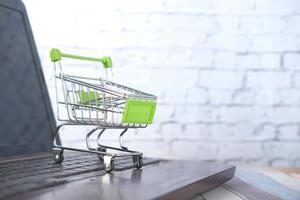 Empty model shopping trolly cart on keyboard photo