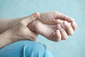 Woman's hands suffering wrist pain photo