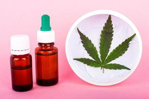 Cannabis-based cosmetic oils, bottles with marijuana extract photo