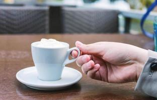 Female hand holding coffee photo