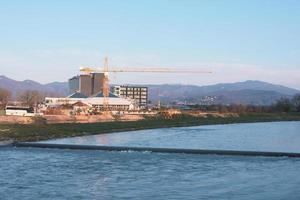 Building construction site at blue river coast photo