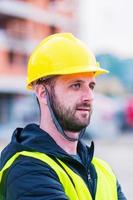 Portrait of construction worker on building site photo