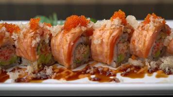 salmon sushi roll with sauce on plate - Japanese food style