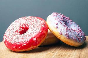 Two donuts with icing photo
