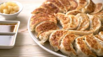 fried gyoza or dumplings snack with soy sauce in Japanese style