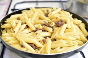 Cooked Italian pasta in a frying pan