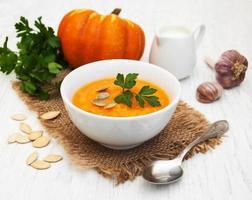 Pumpkin soup on a table photo