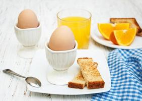 Boiled eggs for breakfast on an old wooden table photo