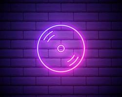 Glowing neon CD or DVD disk icon isolated on brick wall background. Compact disc sign vector