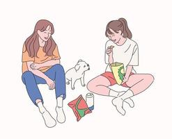 Two friends are sitting on the floor, eating snacks, watching the puppy and having fun. hand drawn style vector design illustrations.