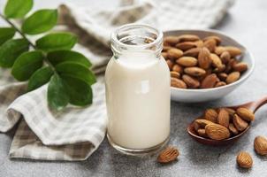 Almond milk and almonds photo