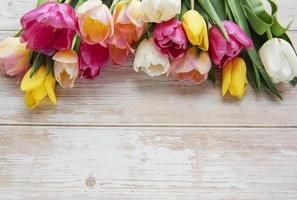 Spring tulips on a wooden background photo
