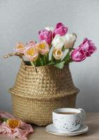 Basket with spring colorful tulips photo
