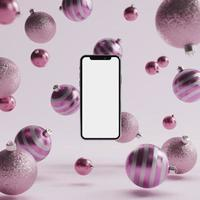 Pink Christmas ornament background with mock up smart phone photo
