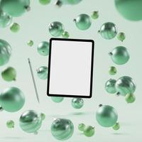 Mock up smart tablet with green Christmas ornament background photo
