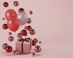 regalo de navidad y adornos sobre fondo rosa foto