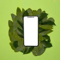Eco friendly recycling concept with mock up smart phone photo