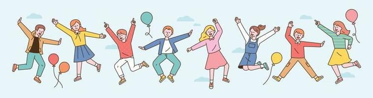 Cute children jumping with their arms up in the sky. flat design style minimal vector illustration.