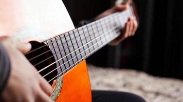 Playing the acoustic guitar, live music and creativity photo