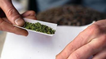 Twisting the jamb with medical marijuana, cannabis treatment close-up