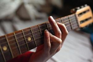 Virtuoso guitarist playing his acoustic guitar