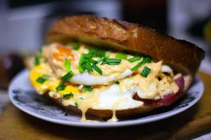 Homemade hot sandwich with egg, cheese and green onion photo