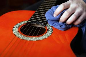 Dusting the acoustic guitar photo
