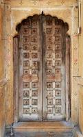 Antique rustic ancient wooden door. Architectural element. photo