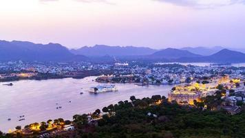 Udaipur city at lake Pichola in the evening, Rajasthan, India. photo